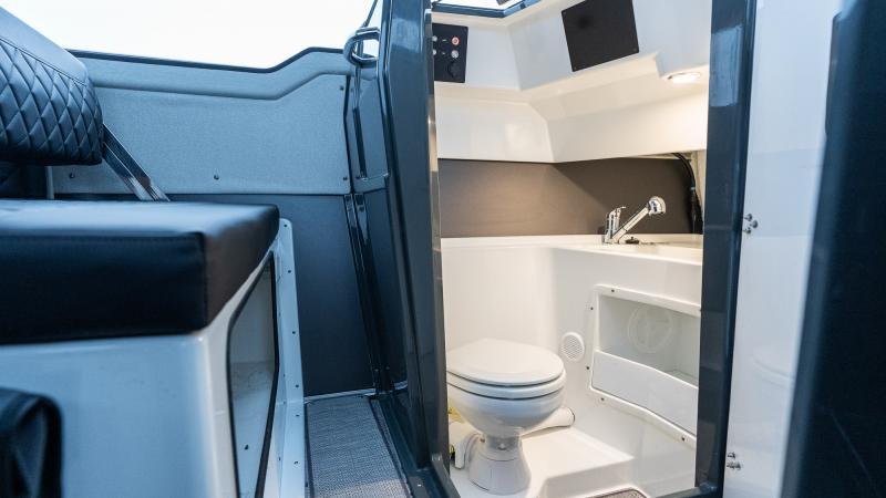 Buster Phantom Cabin has toilet with L-shaped door